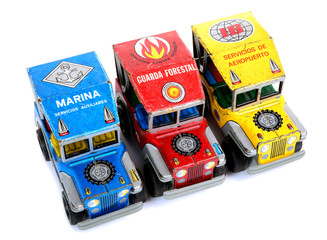 three colored small offroad cars