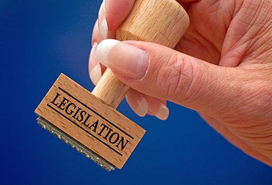 Legislation - female hand with stamp