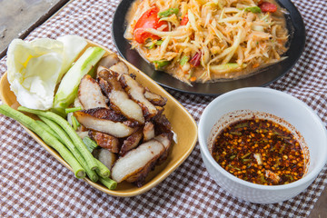 Closeup Thai papaya, charcoal-boiled pork neck,Grill pork (popular food Thailand)
