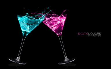 Exotic Liquors. Stemmed cocktail glasses making a toast splashin