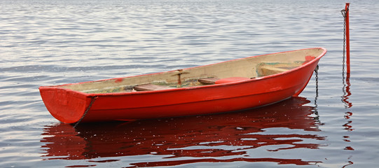 Red boat on the water