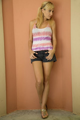 Young female model with a casual expression wearing shorts