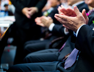 applauding at meeting