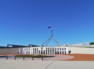The Australian flag half mast on the Parliament building