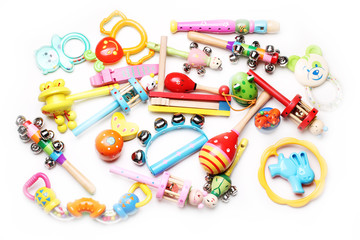 wooden and plastic rattles for children; toys background