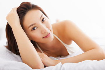 young Beautiful asian woman relaxing on the bed