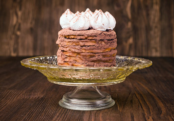 layer cake with cocoa on a stand