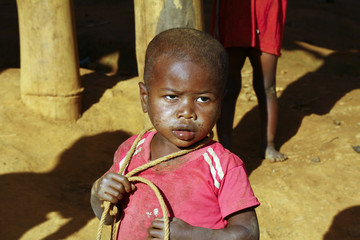 Poor african boy with a string - is he trying to attempt a suici
