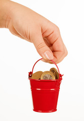 Bucket of money in hand on a white background