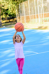 Seven year old playing basketball