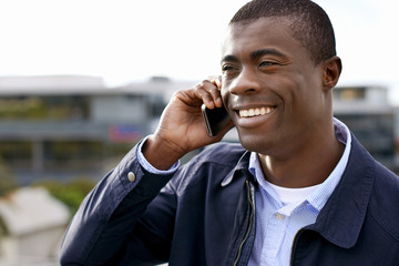smiling phone african man