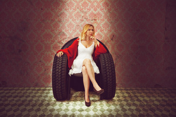 Young woman in armchair made of tires