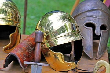 sword and helmets of ancient Roman origin and medieval helmets o
