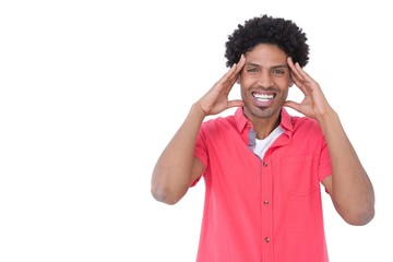 Excited casual man with hands on face