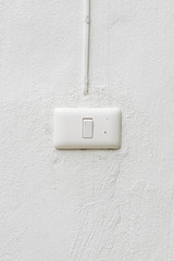White light switch on the wall