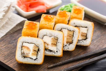 Fried sushi roll with eel and japanese omelette