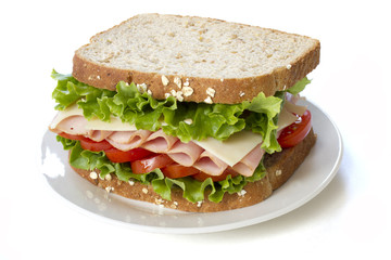 Ham Sandwich on a white plate. Isolated on white