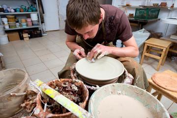 potter, creating an earthen jar