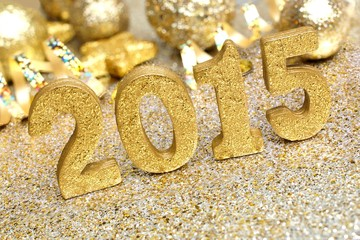 2015 New Years Eve golden numbers with shiny decorations