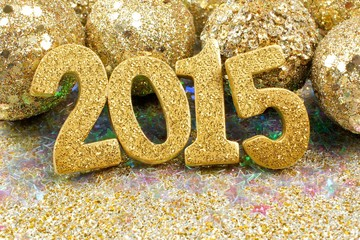 2015 New Years Eve golden numbers with glittery decorations