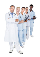 Happy Multiethnic Medical Team Standing In Row