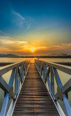 long jetty with sunrise view.
