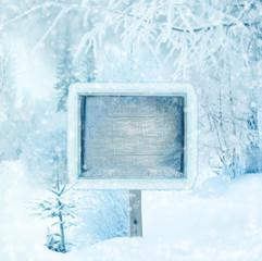 Winter background, scene, landscape. Wooden sign in the winter f