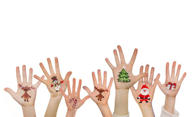 Childrens hands raising up with painted Christmas symbols