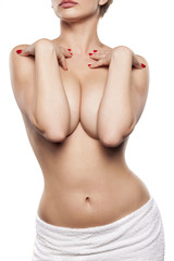 female torso with hands covering breasts