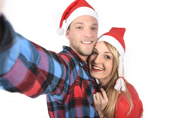 young couple taking Christmas love selfie mobile picture