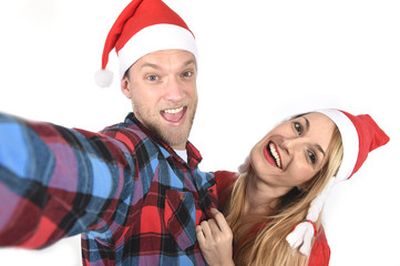 young romantic couple taking love Christmas selfie mobile photo