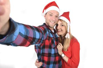 Christmas couple taking love selfie mobile phone photo