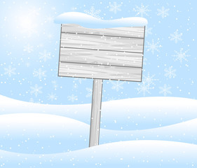 wooden banner stands on to snow