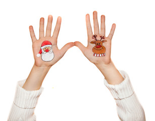 Children's hands raising up with painted Christmas symbol