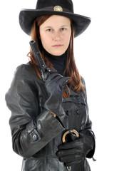 Frau in Sheriff Kostüm mit Pistole zu Karneval