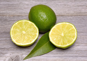 Limes citrus fruit on wooden background