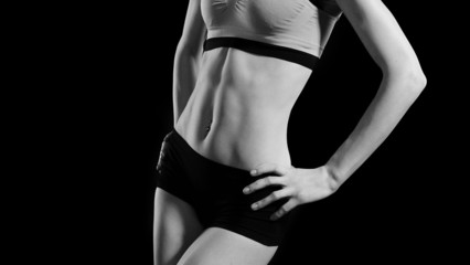 sporty abdomen of young woman