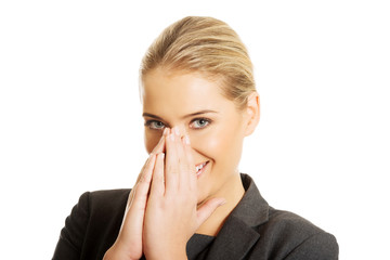 Laughing woman covering her mouth