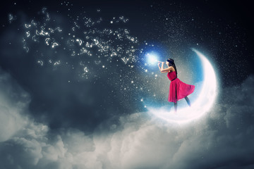 Woman standing on moon