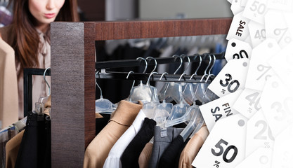 Girl is looking for a perfect clothing on sale