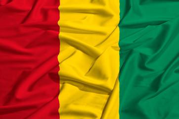 Guinea flag on a silk drape waving