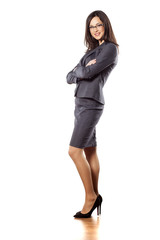 pretty young businesswoman posing with arms folded