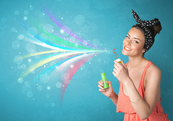 Beautiful girl blowing abstract colorful bubbles and lines