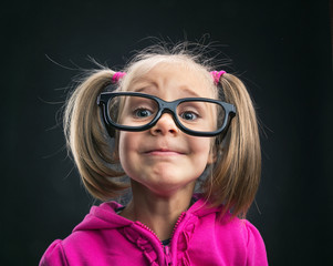Funny little girl in funny big spectacles