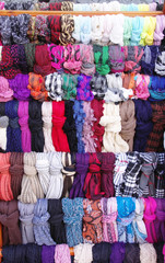 Colorful hanging scarves in shop