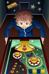 Man playing pinball machine