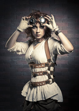 Redhair girl with steampunk goggles