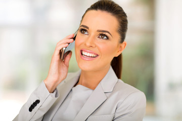 Fototapete - business woman talking on cell phone