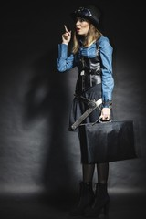 beautiful steampunk woman with bag on black.
