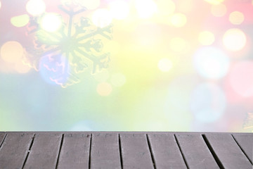 Christmas winter background with wooden table and blurred bokeh